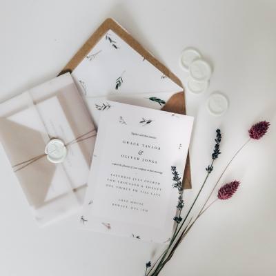 Minimalist foliage wedding invite with vellum jacket and wax seal