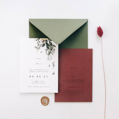 Vines and gold leaf wedding invitations with coloured envelopes