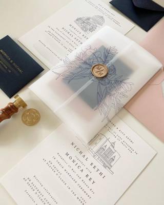 Hand drawn venue wedding invitation with floral vellum jacket