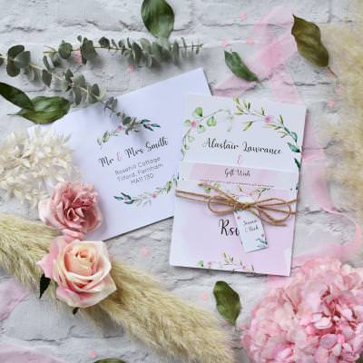 Pink watercolour and foliage leaves wreath wedding invitation