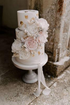 Wedding cake sugar flowers and gold leaf