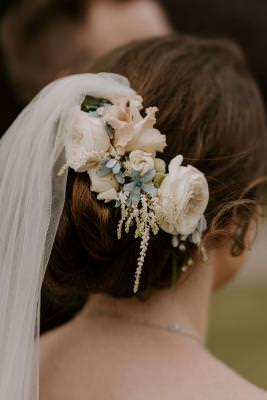 Elegant bridal updo with flower comb