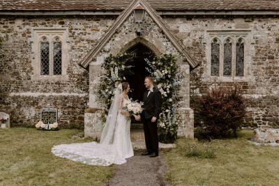 12thy century church wedding Dorset floral arch