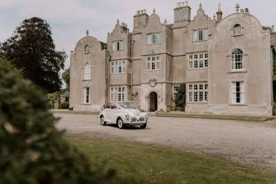 Edmondsham House wedding transport with classic car