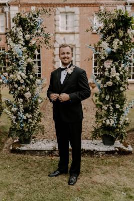 Groom wearing wedding tuxedo