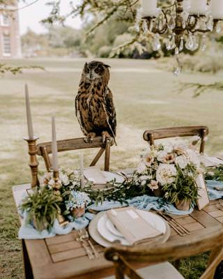 Luxury rustic wedding tablescape with owl waiter
