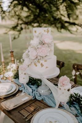 Luxury three tier wedding cake and mini cakes