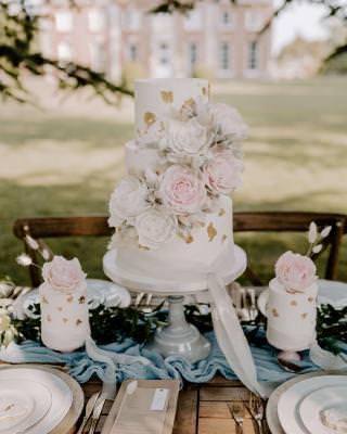 Large wedding cake and matching mini cakes