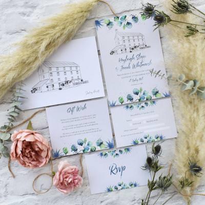 Hand drawn wedding venue eucalyptus detail wedding invitation set