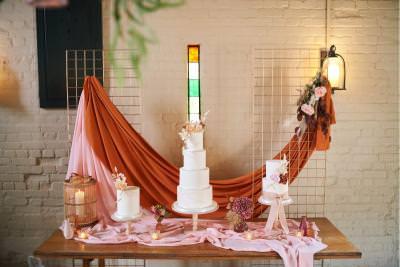 Boho wedding cake display drapery and mesh background