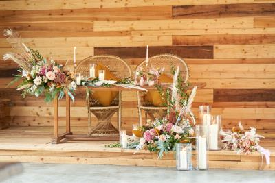 Wedding 'sweetheart' top table with peacock chairs