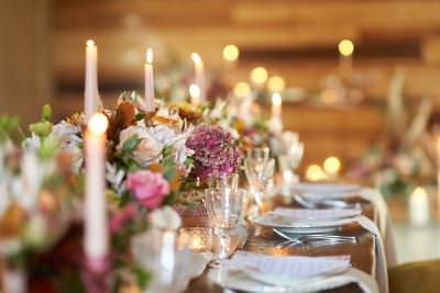 Low level wedding centrepieces with candles - romantic boho