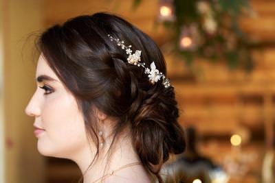 Bridal wedding loose updo with hair vine